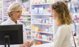 Pharmacist explaining to a young woman